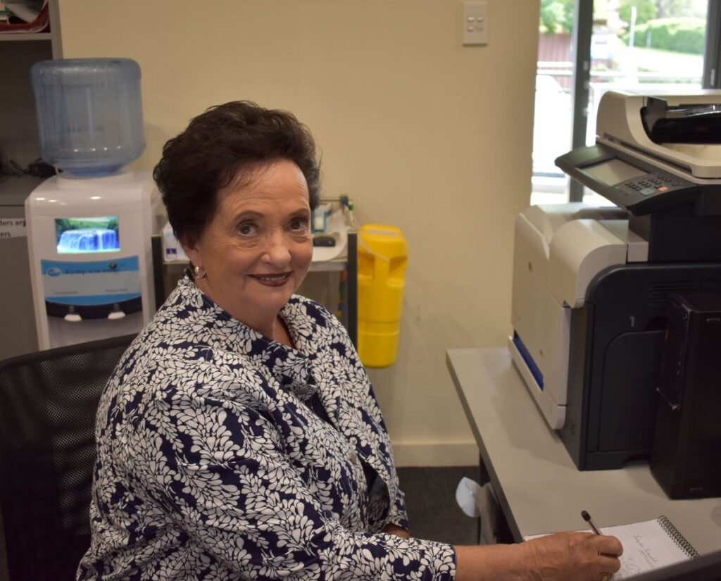 Barbara working as the receptionist at the Ozone Clinic.